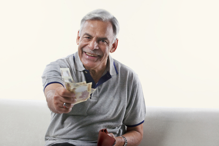 rupees: Portrait of an old man offering money Stock Photo