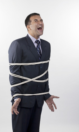welldressed: Businessman tied up with rope