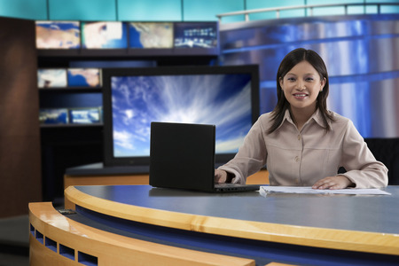 Portrait of female anchor in newsroom