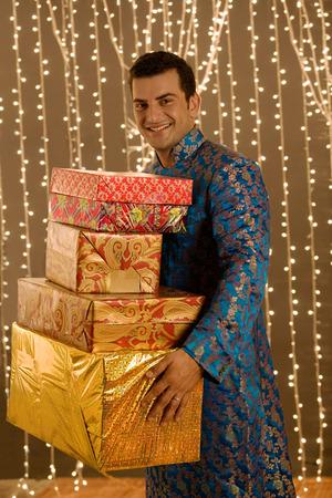 kurta: Indian man holding presents