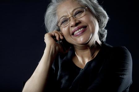 joyfulness: Old woman with glasses smiling Stock Photo