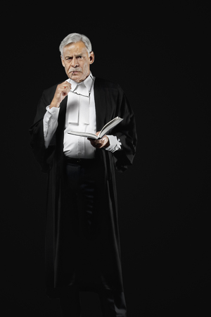 appearance: Lawyer holding a law book