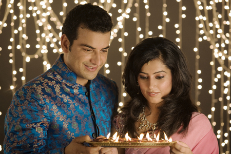 Couple with a tray of diyas