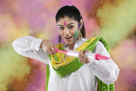 Woman with a pichkari Imagens