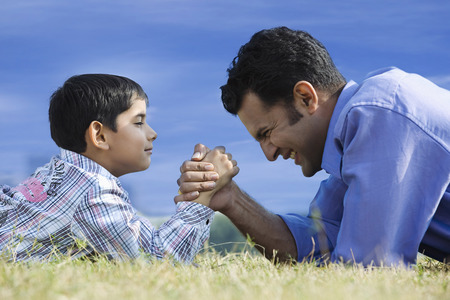 Hand wrestling between son and father