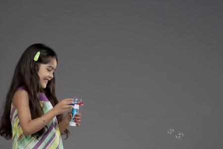 joyfulness: Girl playing with bubbles