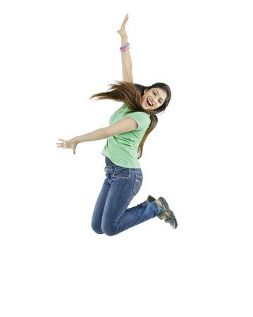 joyfulness: Girl jumping in the air Stock Photo