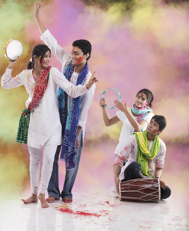 Friends enjoying Holi Stock Photo