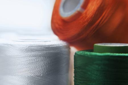 tricoloured: Different coloured spools Stock Photo