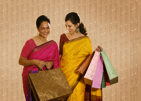 down lights: Mother and daughter holding shopping bags