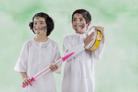Kids enjoying themselves on holi Imagens
