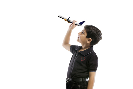 replica: Young boy holding a model of a plane