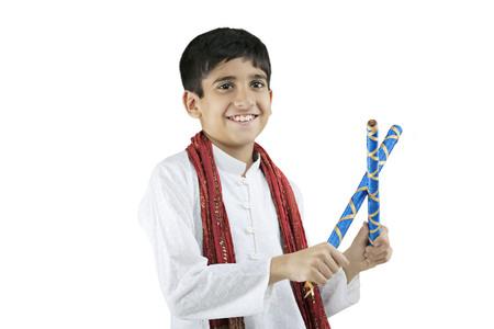 joyfulness: Gujarati boy with dandiya sticks