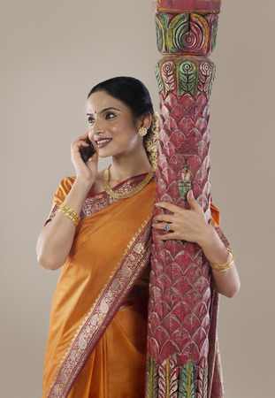 gajra: South Indian woman talking on a mobile phone Stock Photo