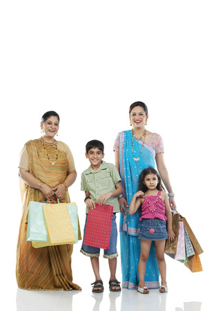 Gujarati family with shopping bags