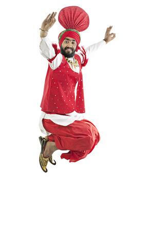 kurta: Sikh man jumping in the air