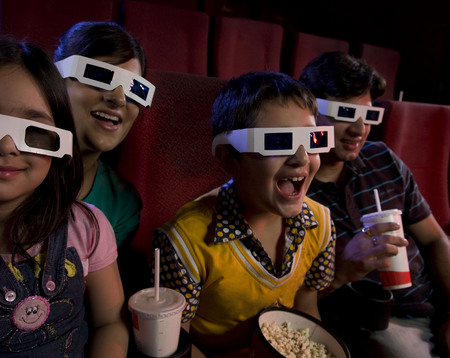 Family watching a movie with 3D glasses