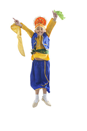 cheerfulness: Sikh boy jumping in the air Stock Photo