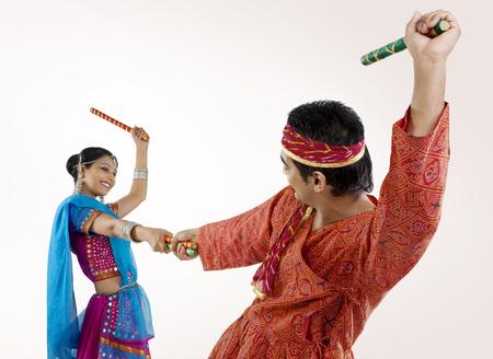 Gujarati couple performing dandiya