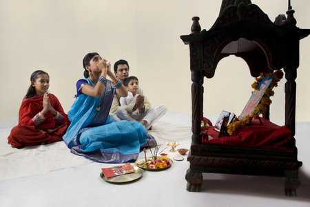 west bengal: Bengali family performing a puja Stock Photo