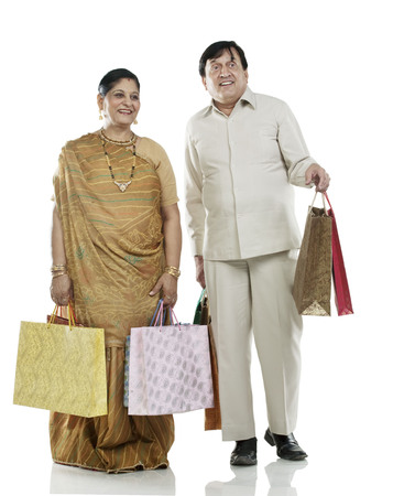 Gujarati couple with shopping bags