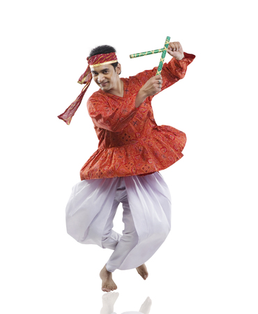 Gujarati man performing dandiya Stock Photo