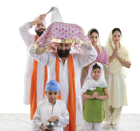 the grand daughter: Sikh family performing a ritual ceremony