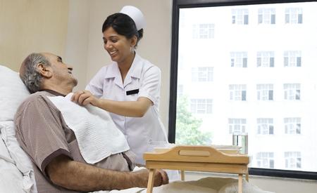 recuperating: Nurse helping a patient