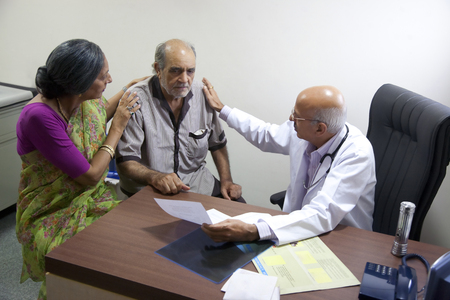 55 years old: Doctor consoling his patient Stock Photo