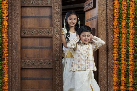 gajra: South Indian girl standing with her brother Stock Photo