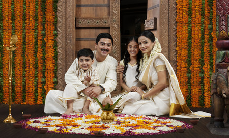 gajra: South Indian family with flower rangoli