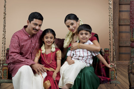 front house: Portrait of a South Indian family sitting on a jhula