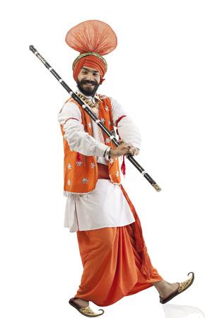 religious clothing: Sikh man holding a Khundi