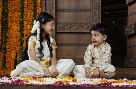 gajra: South Indian girl sitting with her brother