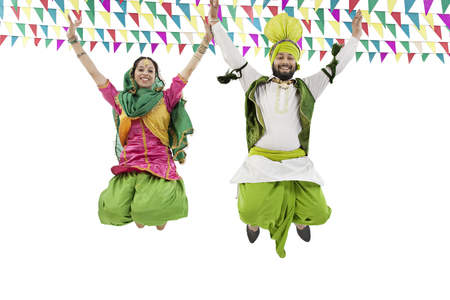 kurta: Sikh couple jumping in the air