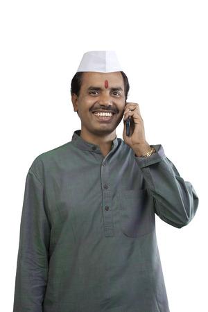 kurta: Man talking on a mobile phone
