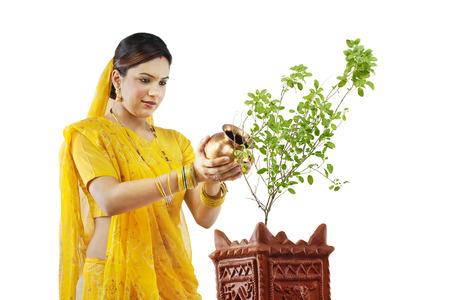 Gujarati woman making an offering