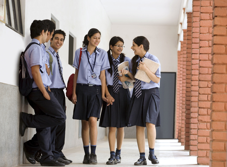 classmate: Students walking in the corridors of a school Stock Photo