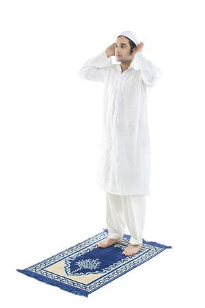 religious clothing: Muslim man praying