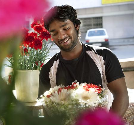 cheerfulness: Florist making a bouquet