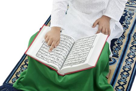 10 fingers: Muslim boy reading the Quran