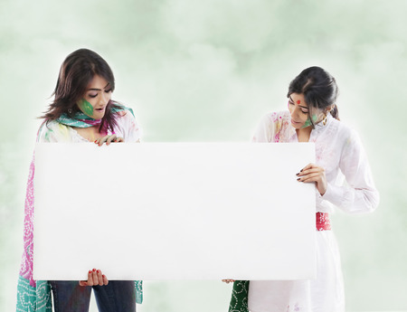 Two women holding a placard Stock Photo