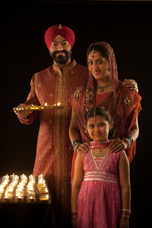 punjab: Portrait of a Sikh family with diyas
