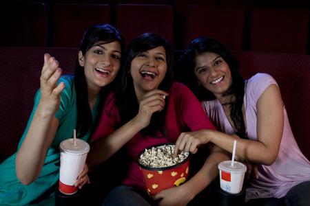joyfulness: Girls watching a movie