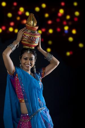 Gujarati woman holding a kalash