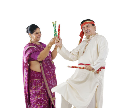 kurta: Couple performing dandiya dance