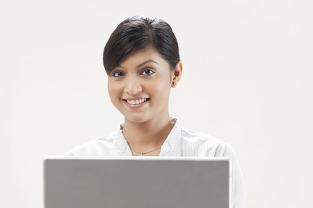 welldressed: Elegant young woman using laptop