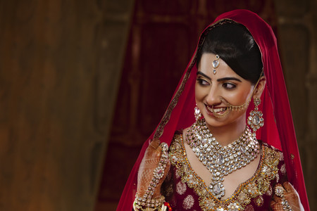 nose ring: Smiling bride in traditional clothing and jewelry