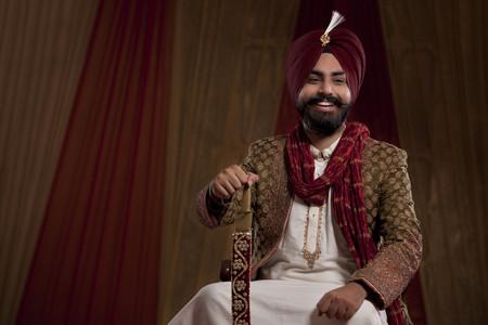 punjabi: Smiling groom with sword