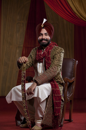 kurta: Portrait of smiling man in traditional clothes Stock Photo